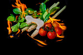 Burning Thai Tom Yam herbs and spices on black background