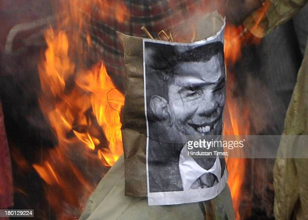 CPI burning the effigy of US President Barak Obama to protest against US attack on Iran and Syria at Park Street on September 9 2013 in Kolkata India