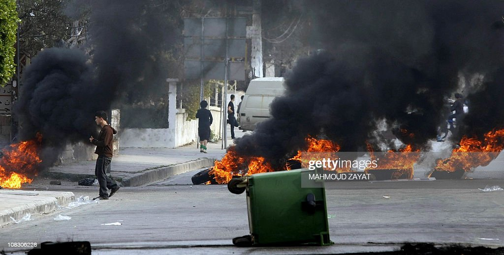 Burning tires are seen during a demonstration in support of the caretaker prime minister Saad Hariri on the outskirts of the coastal city of Sidon, south of Beirut on January 25, 2011, as Lebanese President Michel Sleiman appointed Hezbollah-backed candidate Najib Mikati as prime minister-designate to succeed Saad Hariri, whose pro-Western cabinet collapsed earlier this month.
