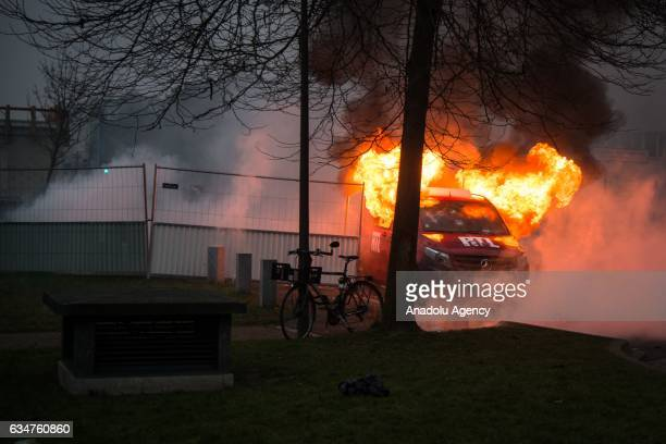 A burning vehicle is seen during a violent protest against police violence that erupts following an alleged police violence over a youth footballer...
