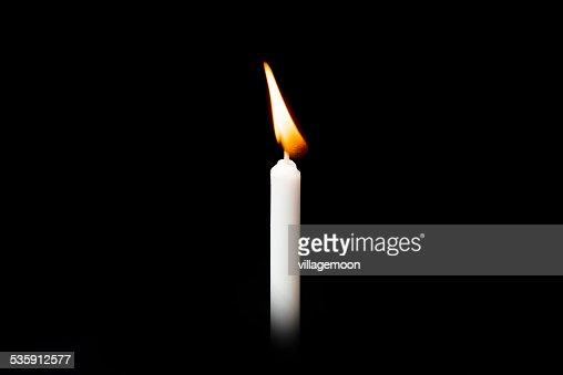 Burning white candle on black background : Stock Photo