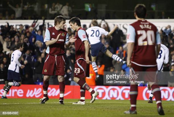 Burnley captain Graham Alexander rallies his team as Tottenham Hotspur's Michael Dawson celebrates in the background after scoring the second goal of...