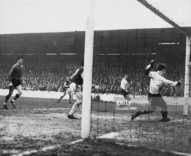 Burnley defender Alex Elder puts the ball in his own net while attempting to clear a shot from West Ham's John Sissons scoring West Ham's first goal...