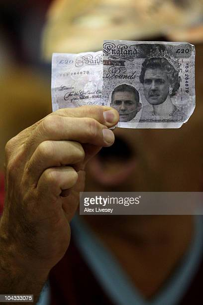Burnley fan shows off a bank note depicting Bolton Wanderers Manager Owen Coyle prior to the Carling Cup Third Round game between Burnley and Bolton...