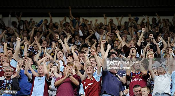 Burnley fans celebrate the goal during the Barclays Premier League match between Burnley and Manchester United at Turf Moor on August 19 2009 in...