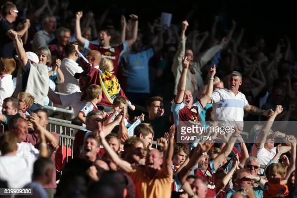 Burnley fans celebrate their late equalizer during the English Premier League football match between Tottenham Hotspur and Burnley at Wembley Stadium...