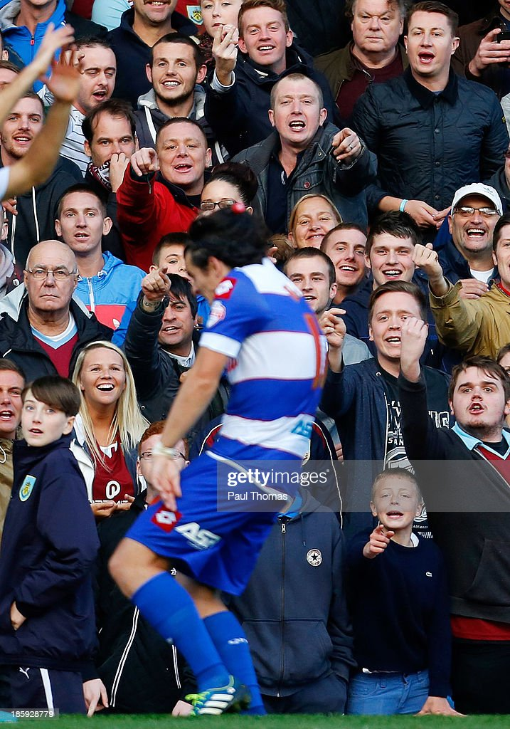 Burnley fans shout abuse towards Joey Barton of QPR as he is hit with a soft drink bottle during the Sky Bet Championship match between Burnley and Queens Park Rangers at Turf Moor on October 26, 2013 in Burnley, England.