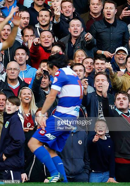 Burnley fans shout abuse towards Joey Barton of QPR as he is hit with a soft drink bottle during the Sky Bet Championship match between Burnley and...