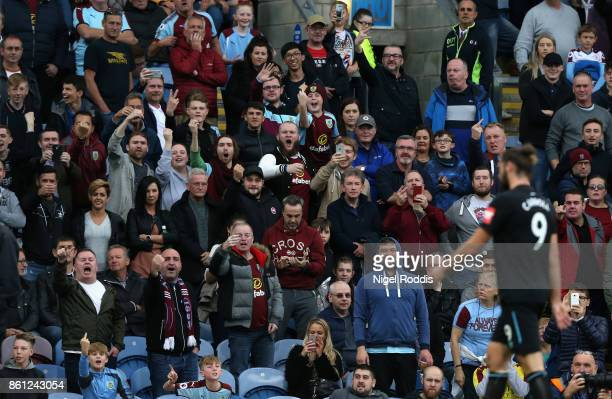 Burnley fans taunght Andy Carroll of West Ham United as he walks off after being sent off during the Premier League match between Burnley and West...