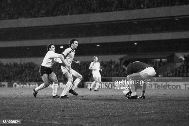 Burnley goalkeeper Alan Stevenson collects the ball as Michael Phelan blocks Tottenham Hotspur's Terry Gibson during the Milk Cup quarter final where...