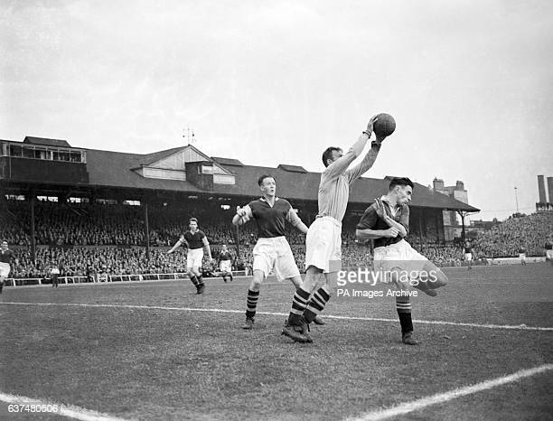 Burnley goalkeeper James Strong claims the ball ahead of Chelsea's Robert Campell and Burnley teammate Thomas Cummings