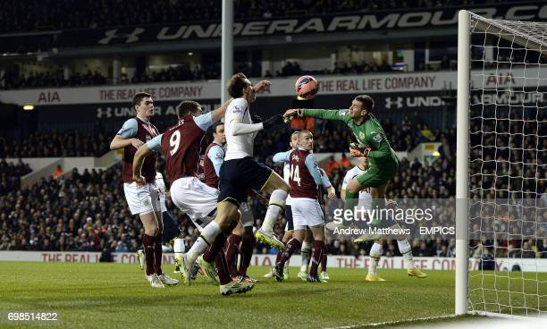 Burnley goalkeeper Thomas Heaton misses the ball just before Tottenham Hotspur's Vlad Chiriches heads homes his side's third goal of the game