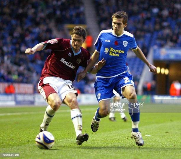 Burnley John Spicer and Leicester's Joe Mattock during the CocaCola Football League Championship match at the Walkers Stadium Leicester