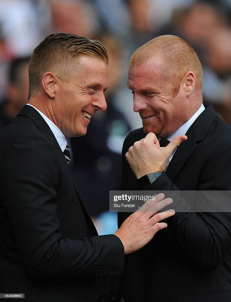 Burnley manager Sean Dyche (r) and Garry Monk of Swansea share a joke before the Barclays Premier League match between Swansea City and Burnley at Liberty Stadium on August 23, 2014 in Swansea, Wales.