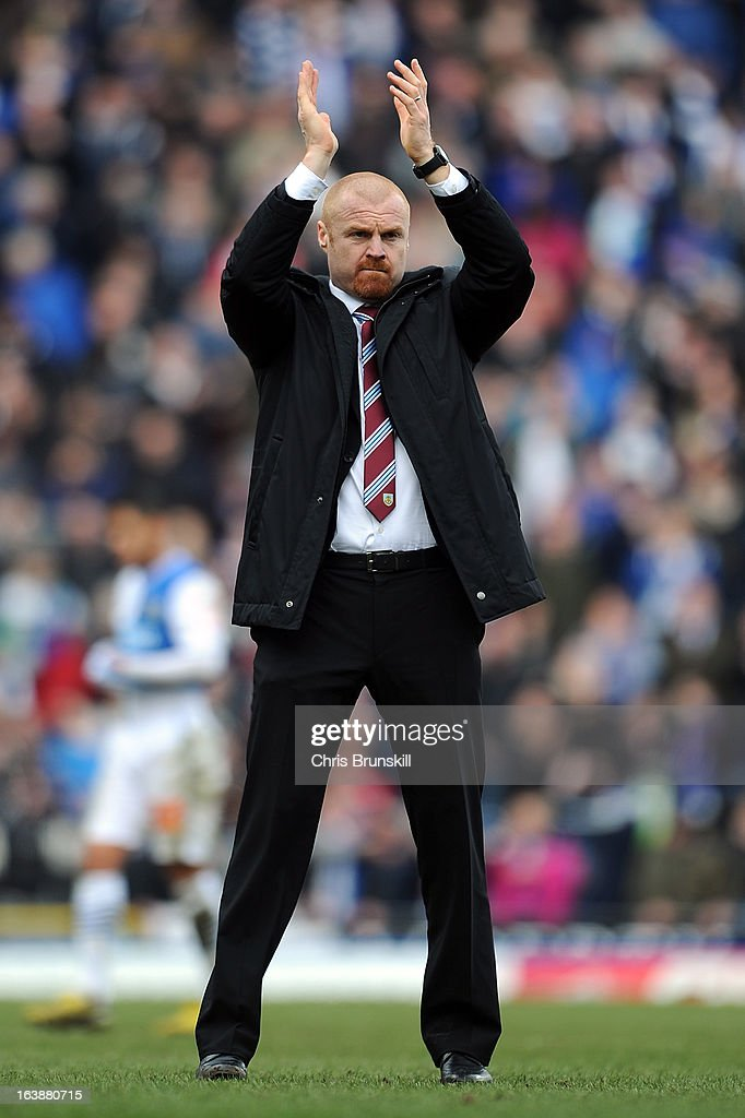 Burnley manager <a gi-track='captionPersonalityLinkClicked' href=/galleries/search?phrase=Sean+Dyche&family=editorial&specificpeople=886017 ng-click='$event.stopPropagation()'>Sean Dyche</a> applauds the supporters following the npower Championship match between Blackburn Rovers and Burnley at Ewood park on March 17, 2013 in Blackburn, England.