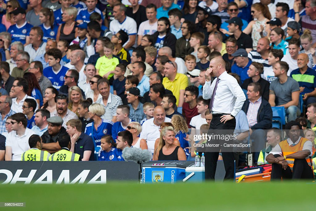 Burnley manager Sean Dyche finds it hard to watch with his side 20 down in the first half during the Premier League match between Chelsea and Burnley...