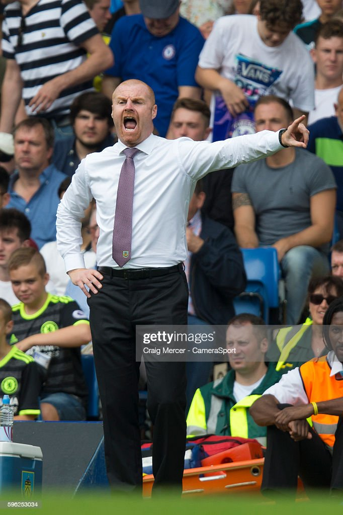 Burnley manager Sean Dyche shouts instructions to his team from the dugout during the Premier League match between Chelsea and Burnley at Stamford...