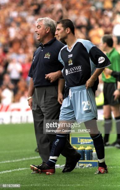 Burnley Manager Stan Ternent prepares to introduce Dimitrios Papadopoulos into the action