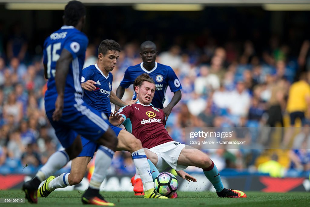 Burnley's Aiden O'Neill battles for possession with Chelsea's Oscar during the Premier League match between Chelsea and Burnley at Stamford Bridge on...