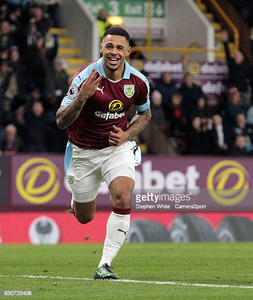 Burnley's Andre Gray celebrates scoring his sides third goal during the Premier League match between Burnley and Sunderland at Turf Moor on December...