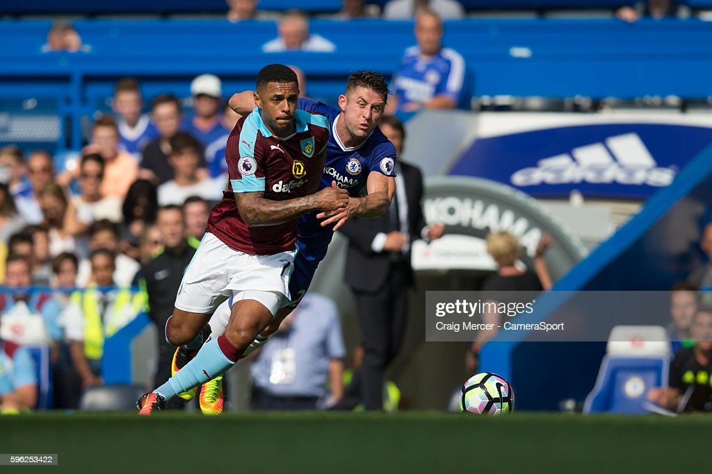 Burnley's Andre Gray holds off the challenge from Chelsea's Gary Cahill during the Premier League match between Chelsea and Burnley at Stamford...