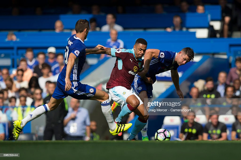 Burnley's Andre Gray holds off the challenge from Chelsea's Gary Cahill and Chelsea's Nemanja Matic during the Premier League match between Chelsea...