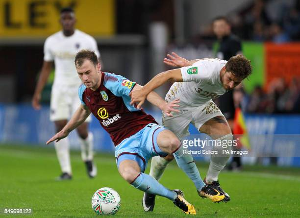 Burnley's Ashley Barnes and Leeds United's Gaetano Berardi battle for the ball during the Carabao Cup third round match at Turf Moor Burnley
