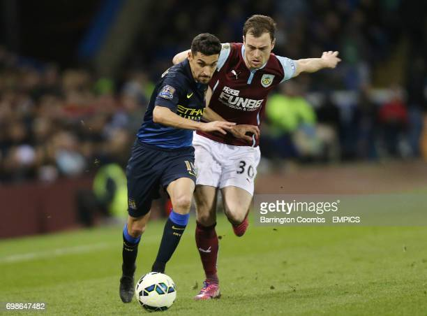 Burnley's Ashley Barnes and Manchester City's Jesus Navas battle for the ball