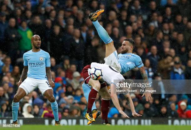 Burnley's Ashley Barnes and Manchester City's Nicolas Otamendi battle for the ball during the Premier League match at the Etihad Stadium Manchester