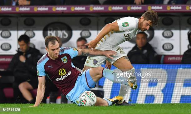 Burnley's Ashley Barnes battles with Leeds United's Gaetano Berardi during the Carabao Cup Third Round match between Burnley and Leeds United at Turf...