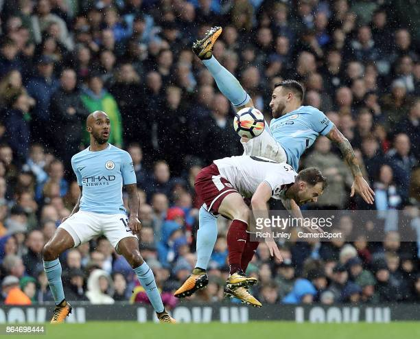 MANCHESTER ENGLAND OCTOBER Burnley's Ashley Barnes battles with Manchester City's Nicolas Otamendi during the Premier League match between Manchester...