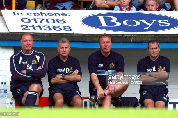Burnley's assistant manager Sam Ellis first team coach Mick Docherty coach Ronnie Jepson and physio Ian Liversedge watch the game from the dugout