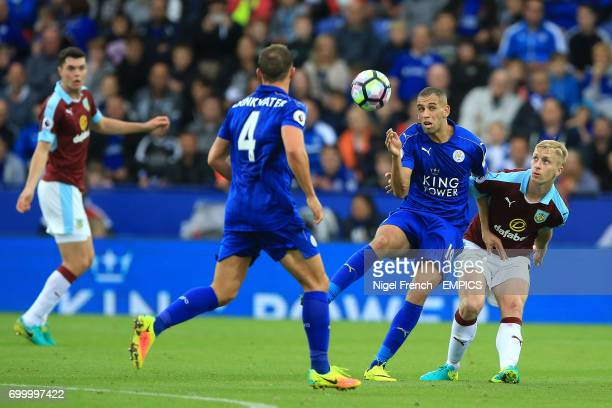 Burnley's Ben Mee and Islam Slimani battle for the ball