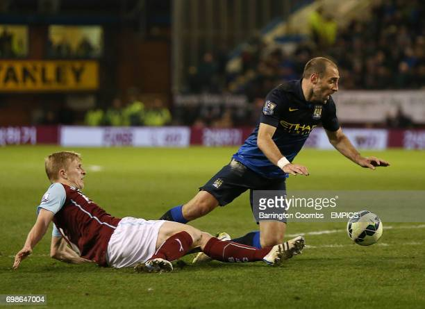 Burnley's Ben Mee makes a late challenge on Manchester City's Pablo Zabaleta leading to shouts for a penalty late in the game
