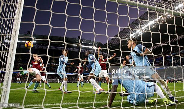 Burnley's Ben Mee scores his side's first goal of the game during the Premier League match at the Etihad Stadium Manchester