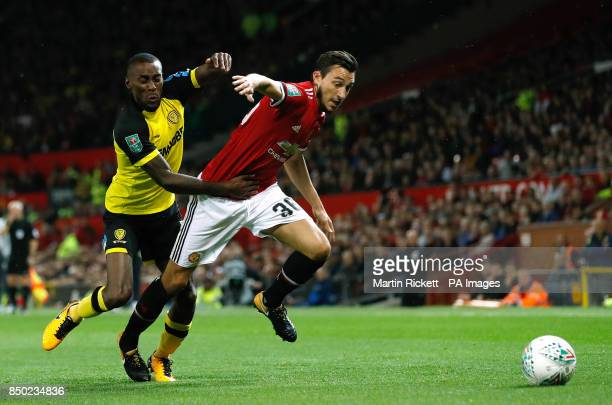 Burnley's Chris Wood and Manchester United's Matteo Darmian battle for the ball during the Carabao Cup Third Round match at Old Trafford Manchester