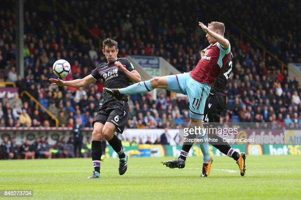 Burnley's Chris Wood battles with Crystal Palace's Scott Dann and Timothy FosuMensah during the Premier League match between Burnley and Crystal...