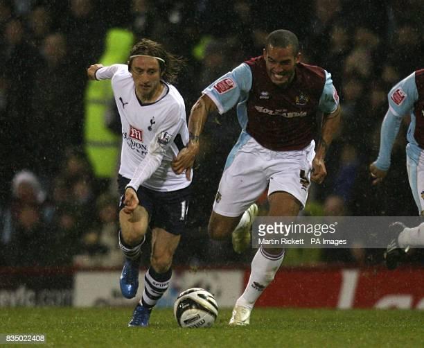 Burnley's Clarke Carlisle and Tottenham Hotspur's Luka Modric battle for the ball