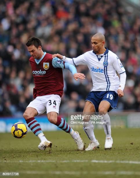 Burnley's Daniel Fox and Portsmouth's Danny Webber battle for the ball