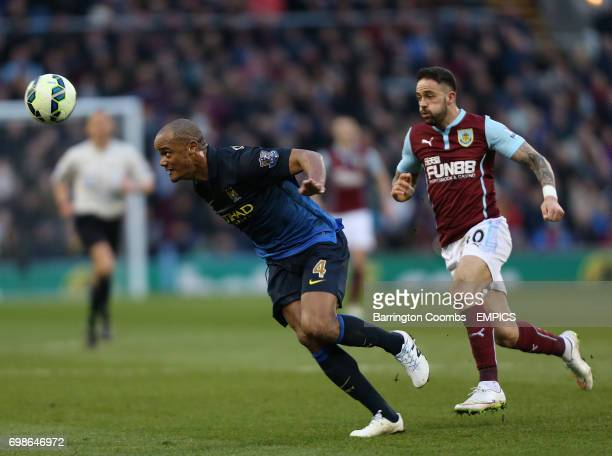 Burnley's Danny Ings and Manchester City's Vincent Kompany battle for the ball