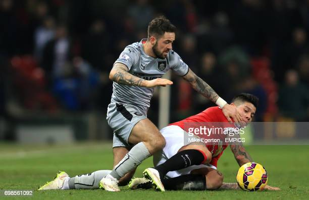 Burnley's Danny Ings and Manchester United's Macos Rojo battle for the ball