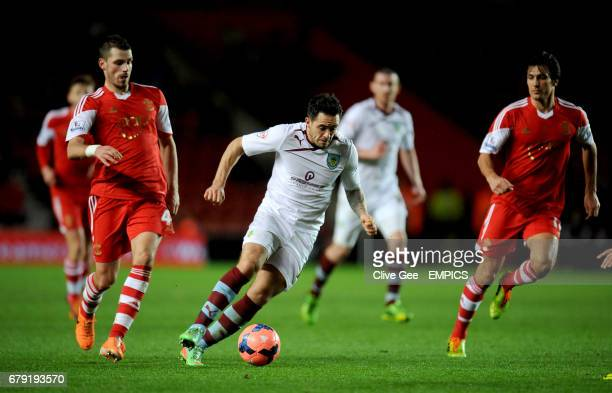 Burnley's Danny Ings dribbles between Southampton's Morgan Schneiderlin and Southampton's James WardProwse during the FA Cup Third Round match at St...
