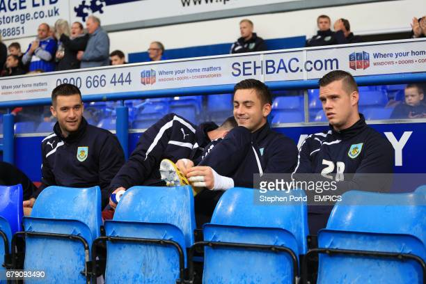 Burnley's David Edgar Alex Cisak and Kevin Long on the substitute's bench