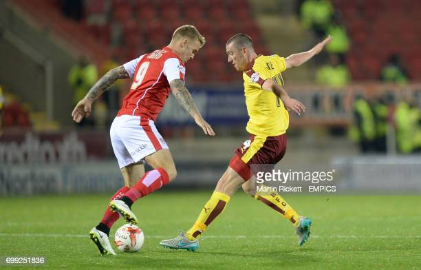 Burnley's David jones battles for the ball with Rotherham United's Danny Ward