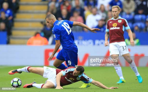 Burnley's Dean Marney and Leicester City's Islam Slimani battle for the ball