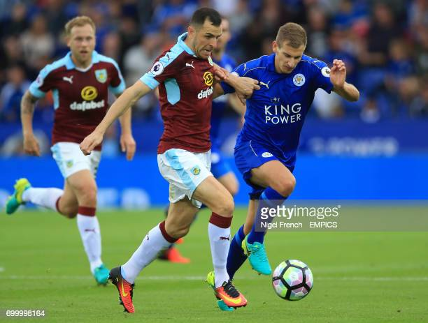 Burnley's Dean Marney and Leicester City's Marc Albrighton battle for the ball