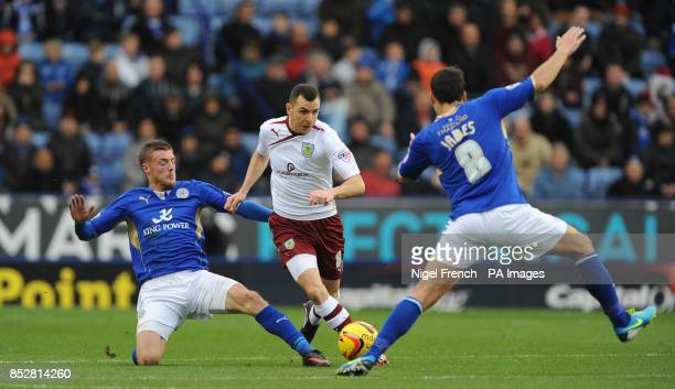 Burnley's Dean Marney is tackled by Leicester City's Jamie Vardie and Matty James during the Sky Bet Championship match at The King Power Stadium...
