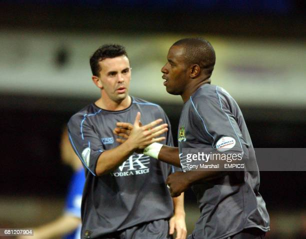 Burnley's Delroy Facey celebrates with Paul Weller after scoring a consolation goal to bring the score to 51 to Ipswich