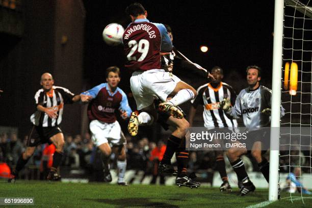 Burnley's Dimitrios Papadopoulos jumps highest to win a header