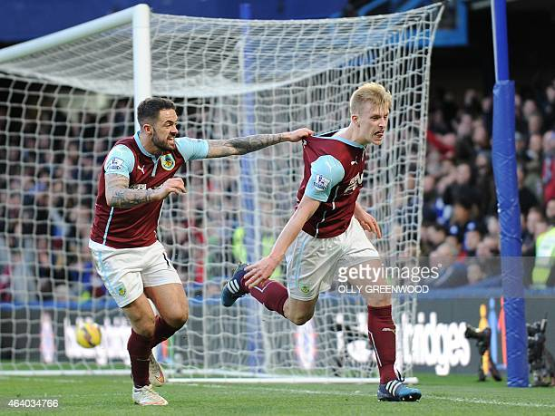Burnley's English defender Ben Mee celebrates with English striker Danny Ings after Mee scored his team's first goal during the English Premier...